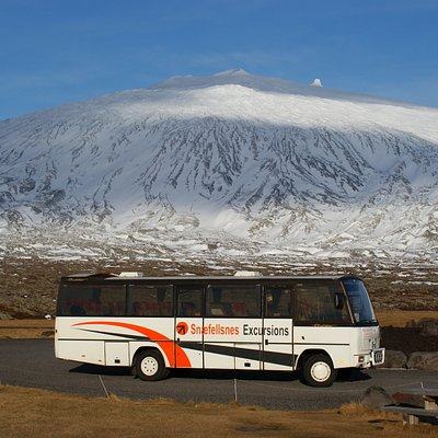 Our Snæfellsnes Excursions bus with the majestic Snæfellsjökull in the background