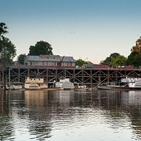 Early morning on the magic Murray River viewing the historic wharf and moored paddlesteamers