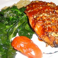 Walnut Crusted Burning River Salmon with sautéed spinach and roasted spaghetti squash.