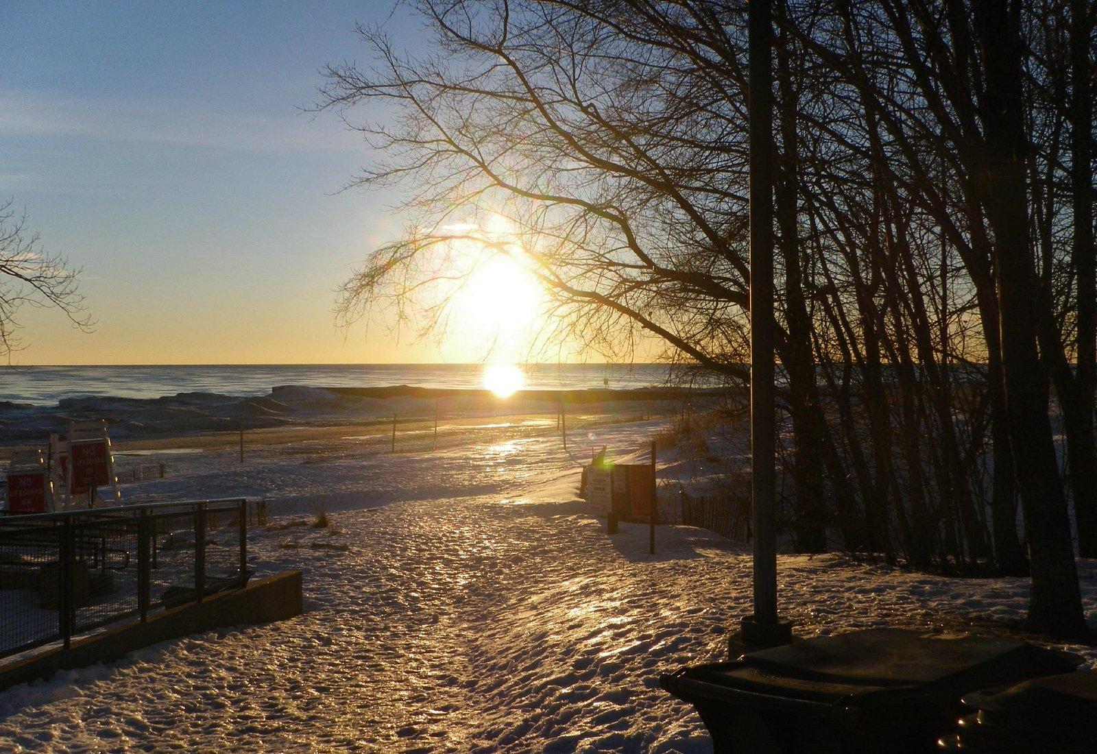 Sunrise in winter on Lighthouse beach Lake Michigan