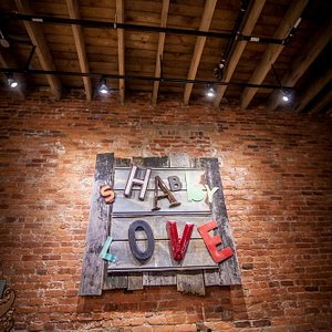 Shabby Love sign hanging over our antique cash register