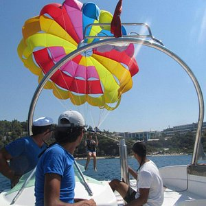 Olympia diving center parasailing it is realy awsome i hope i see my friends there back