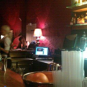 Across the bar.