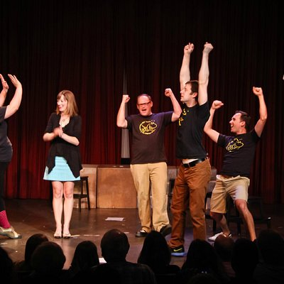 A clearly successful audience volunteer in a Jet City Improv show. Photo by Todd Gardiner.