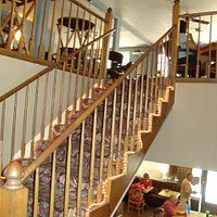 Stairway to two additional dining rooms.