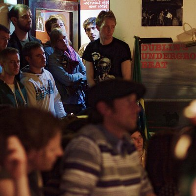 Audience out the door in the International Bar basement