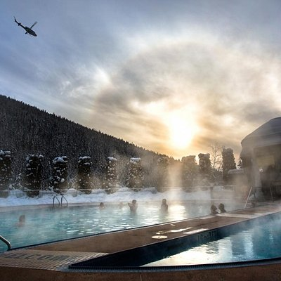 Our lovely pool with a Heli Ski group overhead! Courtesy of Lee Orr