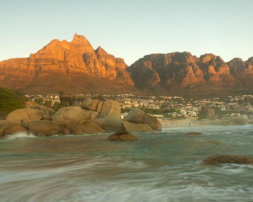 Sun setting at Maiden's Cove looking towards Table Mountain and the Twelve Apostles