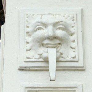 Interesting pillar face seen on the Silpakorn University gate