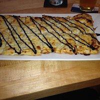 White flat bread- cheesy deliciousness