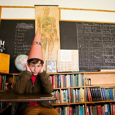 our son wearing the dunce cap in the school room at East Coulee School