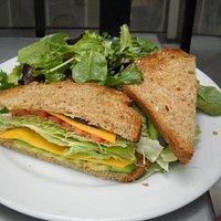 vegetarian sandwich with side green salad