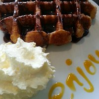 A favorite! Belgian waffle with cream and an option to add vanilla ice cream!