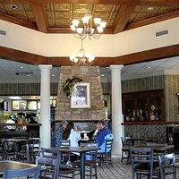 This pic shows the fireplace, columns, lighting and ceiling.