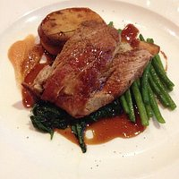Pork with fondant potatoes and beans