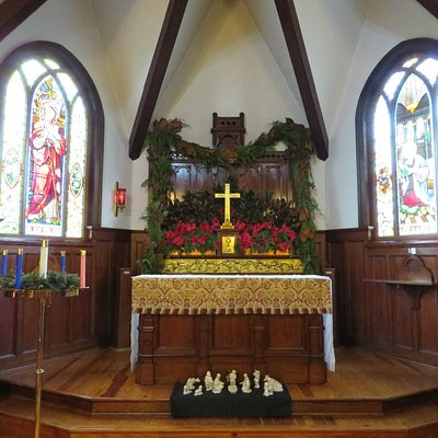 The altar, with the Good Shepherd window (Tiffany, 1886) on left.