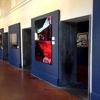 photo of images installed along exposition corridor
