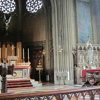 High Altar with organ behind and Shrine of St Joseph in transept