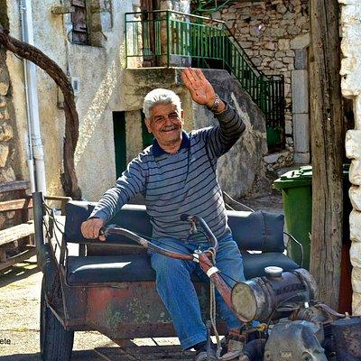 A local man greets us in Krassi village