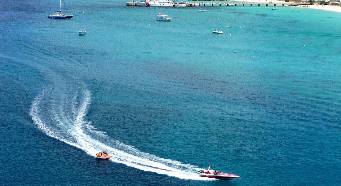 Inner tube excursion boat returning.