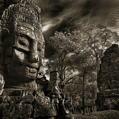 Bayon Face and Clouds, The Bayon, copyright John McDermott