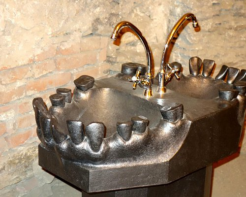 On of a series of sculptures with jaws and teeth.