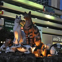 Family Cat Monument lighted up at night