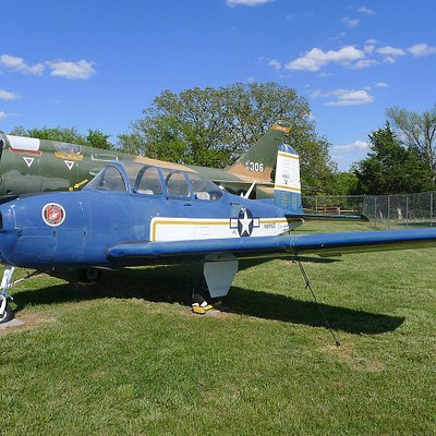 Navy T-34-B mentor next to F-105