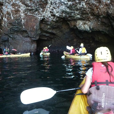 Entering a large cave with direction from guides