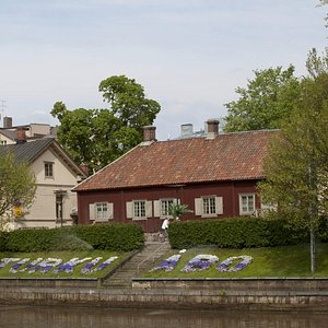 The Qwensel House as seen from the east bank.