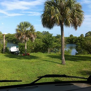 front window view with tampa bay inlet and pontoon boat in back ground