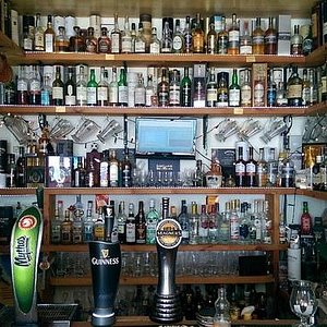 A huge selection of Malt Whisky and draught Mythos, Guiness & Magners
