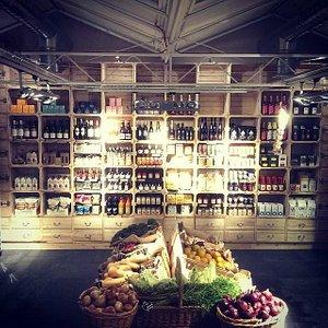 back wall of the food hall with organic veg
