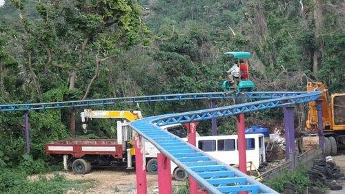 Scary Skyride (see parked vehicles below rail)