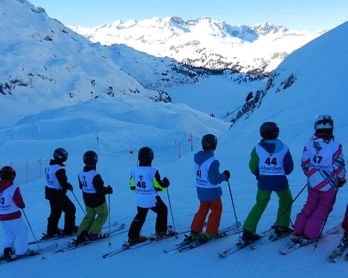 Training for ski school race with instructor
