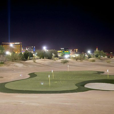 Nightime view of the driving range with Vegas strip in the background