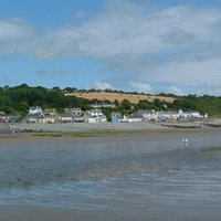 A view across the beach to the village of Amroth