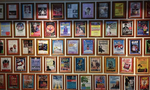 Wall of posters showing more than 10 years of productions