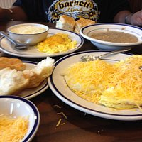 Hmmm Hmmm Hot, Cheesy Grits with omlette and biscuits!