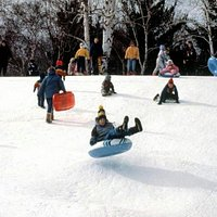 There is a large sledding hill with a tow line.