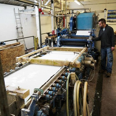 Papermaker Gary besides the 'Pilot' papermaking machine