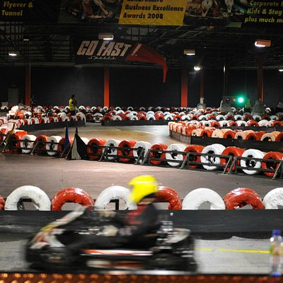 Huge indoor track with a long straight, sweeping turns, hairpins, bridge and tunnel