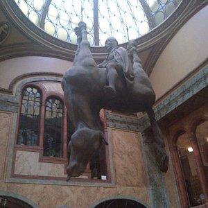 """Sculpture """"Kun"""" (Horse) by David Cerny in Lucerna Arcade"""
