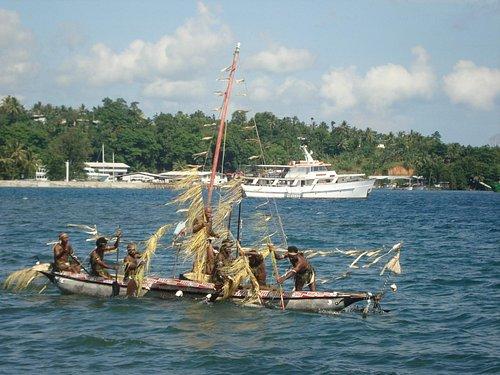 Golden Dawn at the Kundu and Kanu festival in Alotau, Milne Bay, Papua New Guinea.