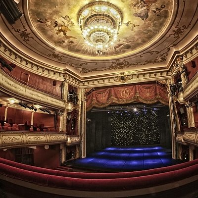 The beautiful auditorium decorated in red and gold.