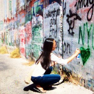 Writing a message on the separation wall directly in front of the store.