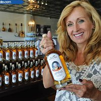 Owner, Eugenia Motte with a bottle of The General