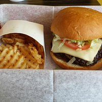 Burger with cheese and waffle fries