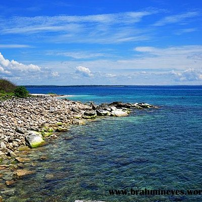 One side of the island has a rocky shoreline.