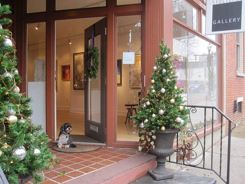 The gallery dog, Gio, is always there to greet you.
